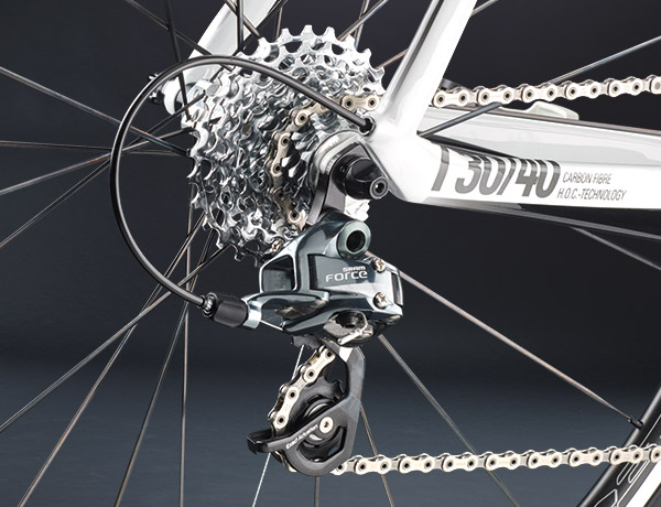 Top rear derailleur with elegant cable routing through the chain stay