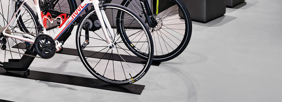 Self-supporting bike stands and bike stands for floor mounting
